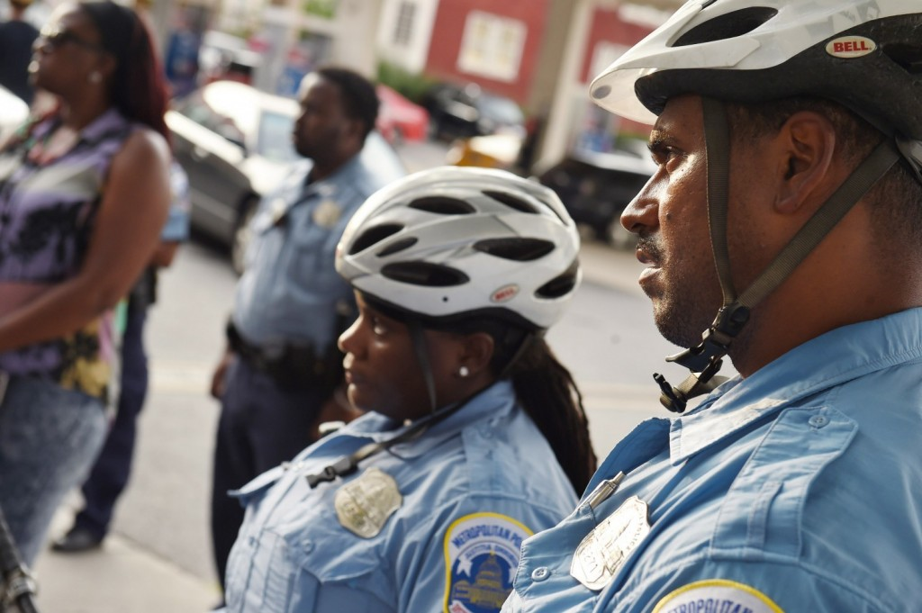 D.C. police officers are seen during a community crime awareness walk in Columbia Heights on Tuesday. (Matt McClain/The Washington Post)